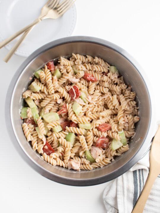 Rotini pasta salad in large bowl.