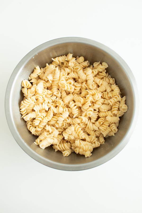 Rotini pasta in a mixing bowl.