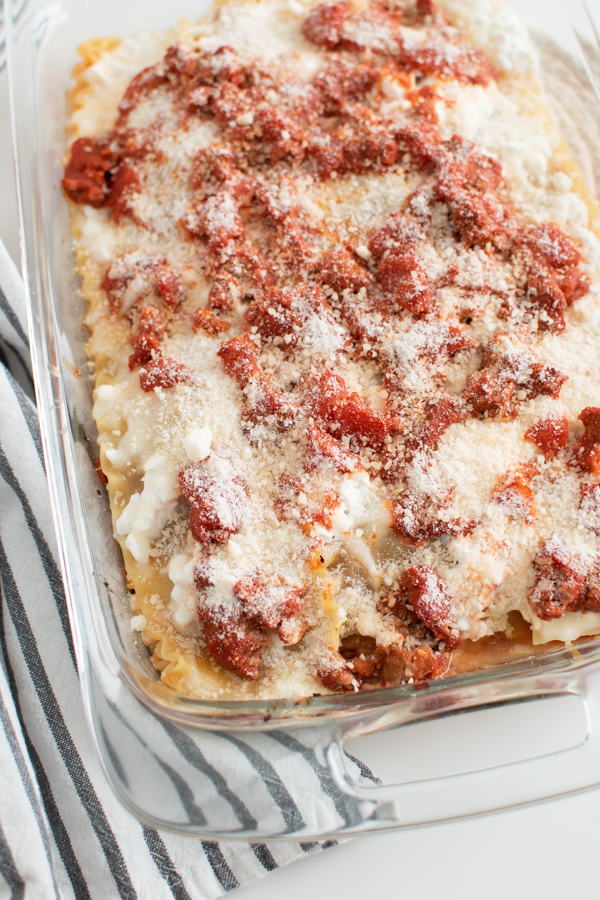 Lasagna with cottage cheese in glass baking dish.