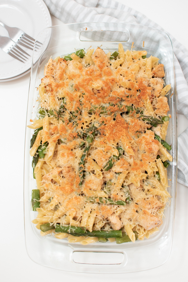Chicken and asparagus pasta in a casserole dish.