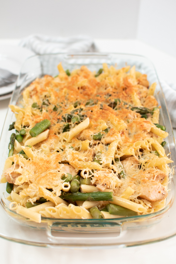 Chicken asparagus pasta bake in a glass dish.
