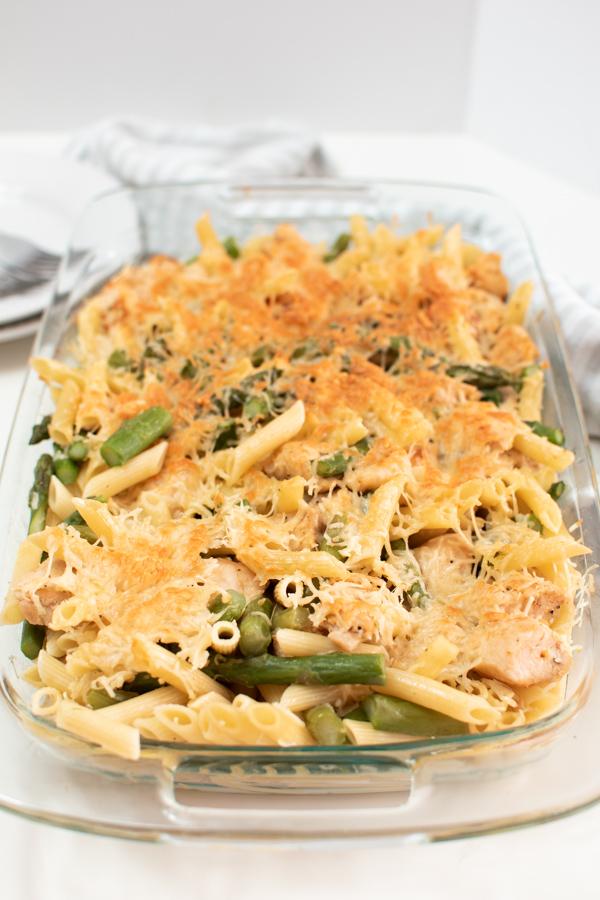 Chicken asparagus pasta bake in a casserole dish.