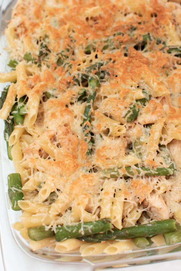 Chicken asparagus pasta in a baking dish.