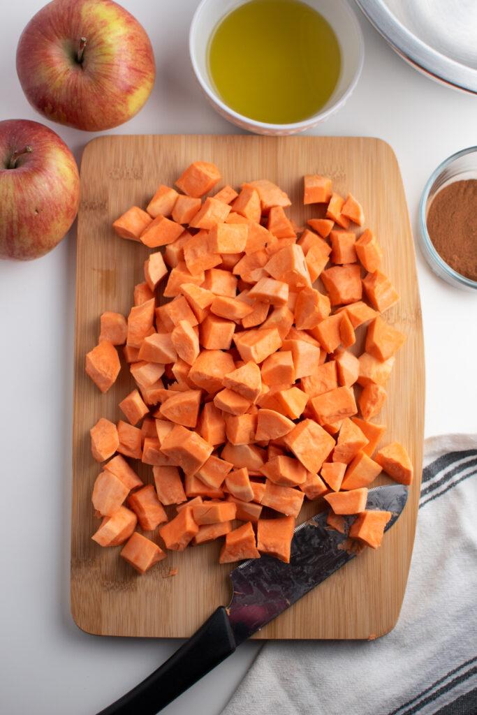 Chopped sweet potatoes on a cutting board.
