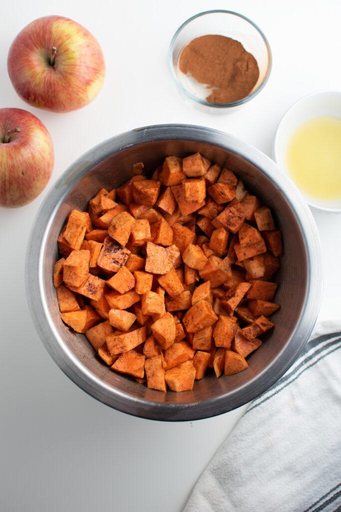 Cinnamon sweet potatoes in a mixing bowl.