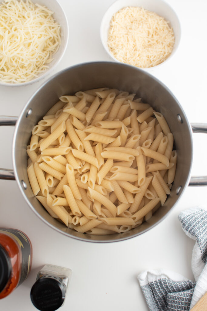 Cooked penne pasta in large pot.