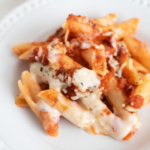 Creamy pasta bake on a white plate.