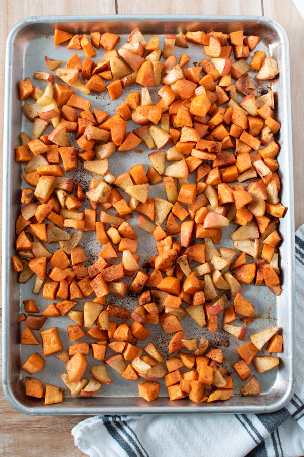 Oven roasted sweet potatoes on a sheet pan.