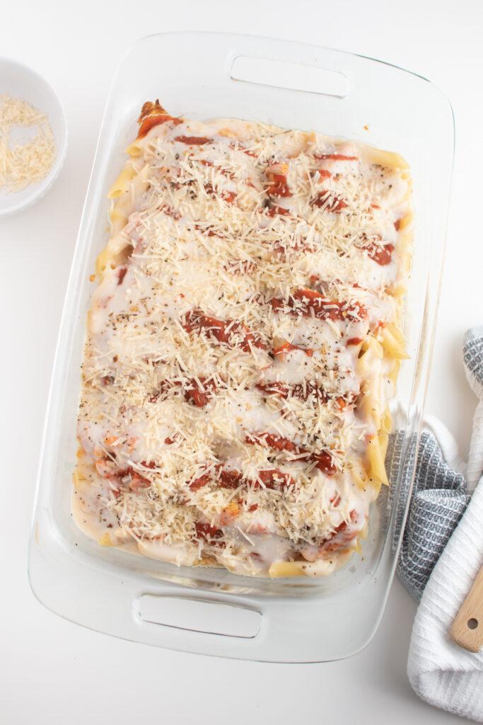 Parmesan cheese on pasta bake dish.