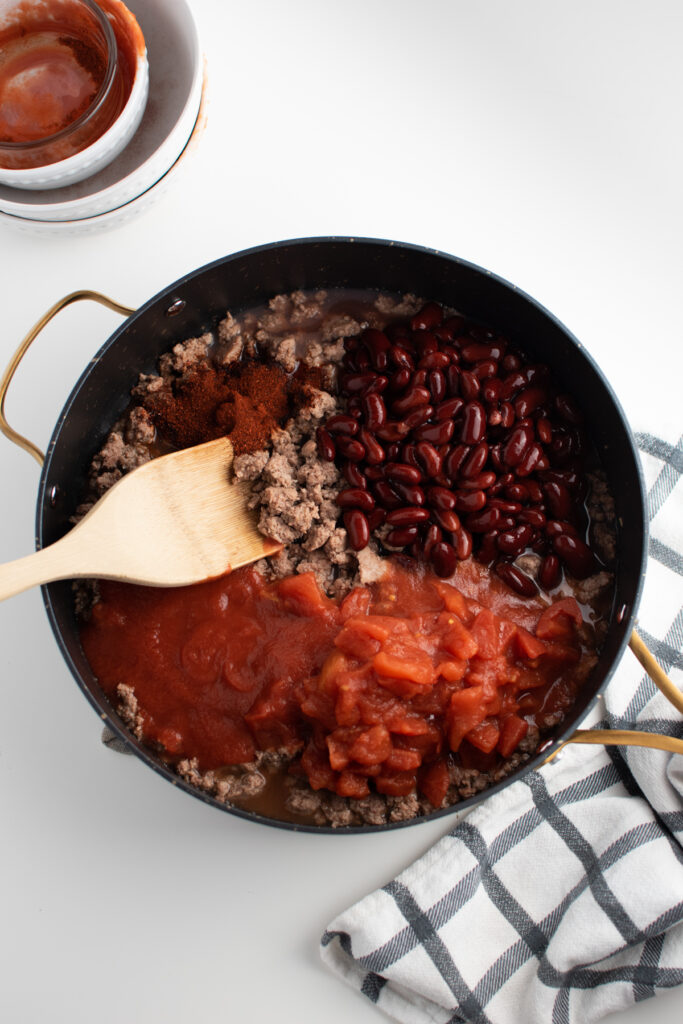 Cincinatti chili ingredients in a pan.