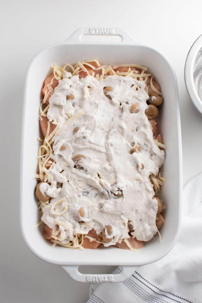 Creamy swiss chicken bake in a white dish.