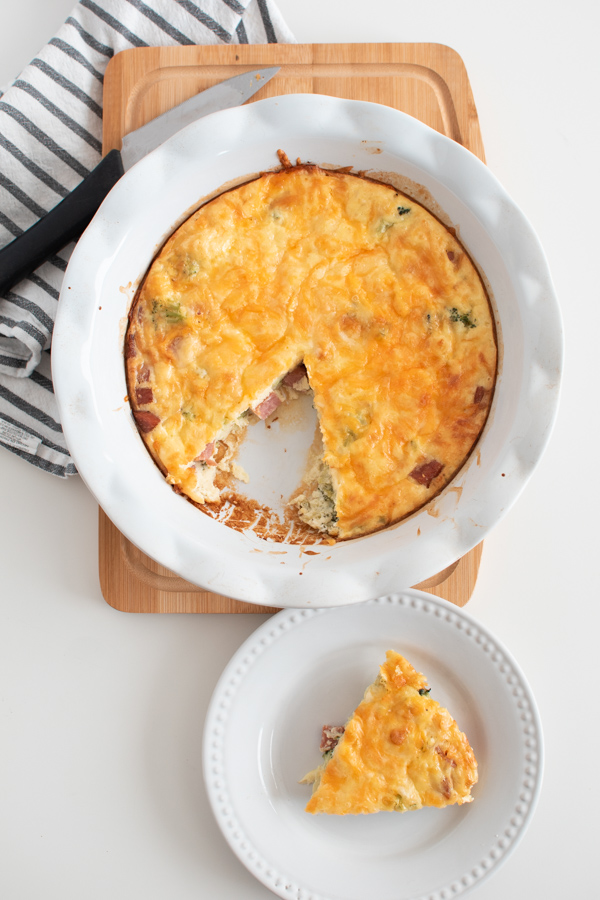Crustless broccoli and ham quiche in a pie dish.