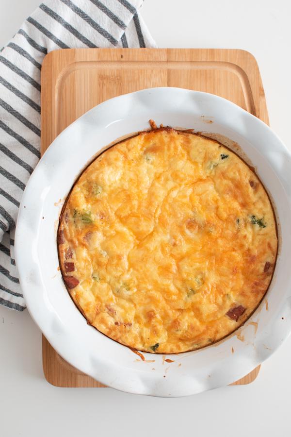 Crustless broccoli cheese quiche in a pie dish.