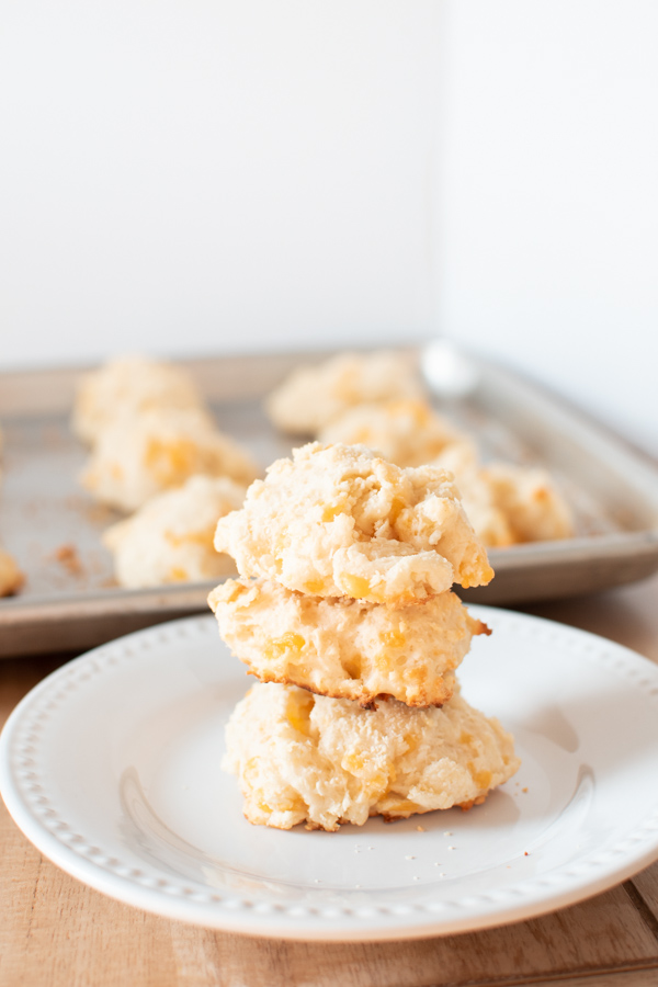 A stack of cheddar drop biscuits on a plate.