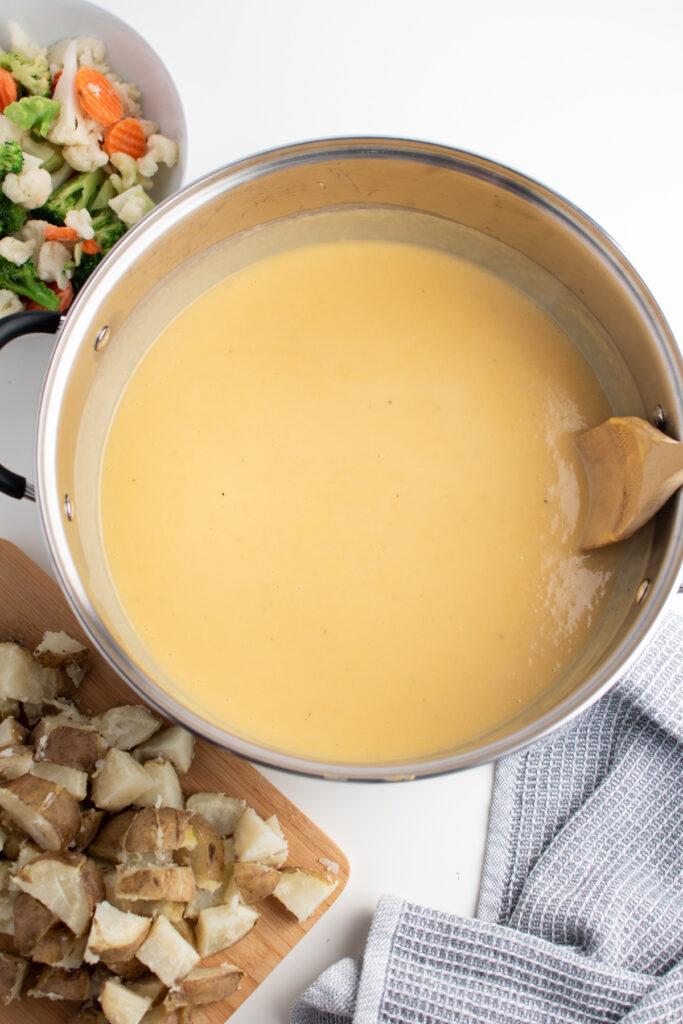 Chowder base in a pot.