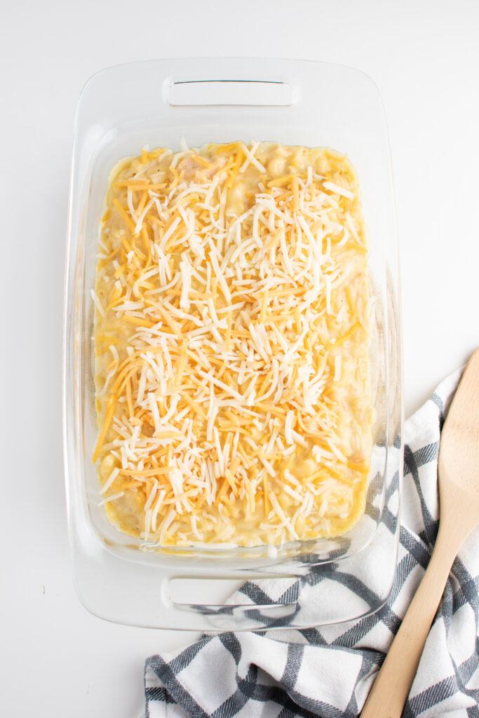Shredded cheese on baked macaroni.
