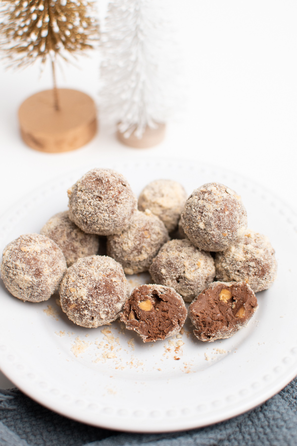 Chocolate almond balls on a white plate.