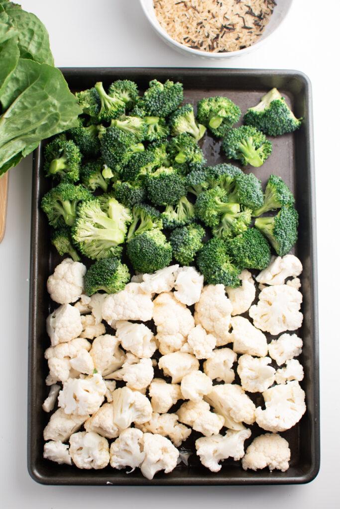 Chopped broccoli and cauliflower on sheet pan.