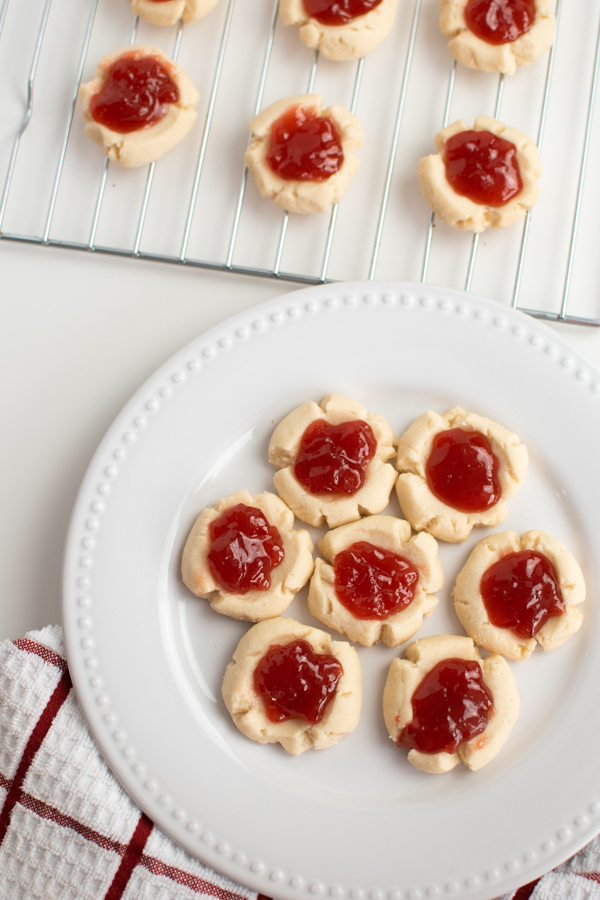 Shortbread thumbprint cookies on a white plate.