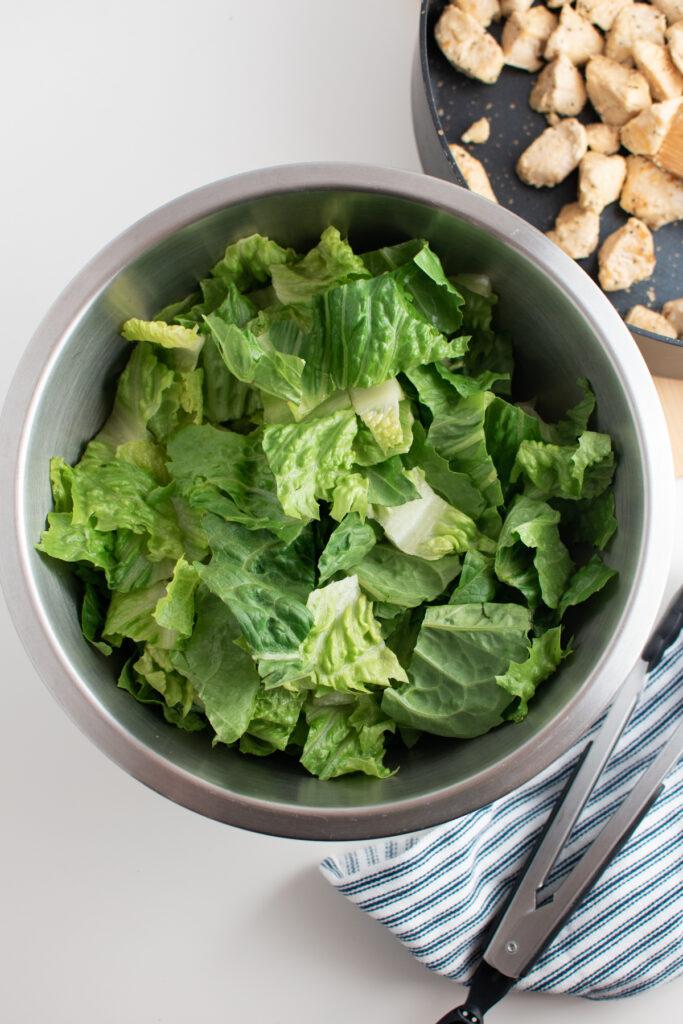Shredded romaine lettuce in bowl.