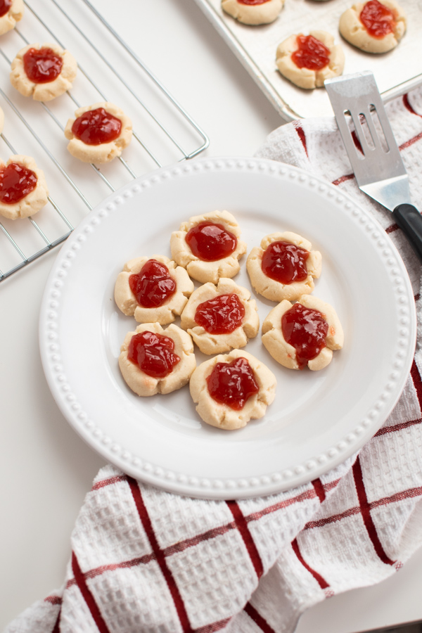 Thumbprint cookies on a white plate.
