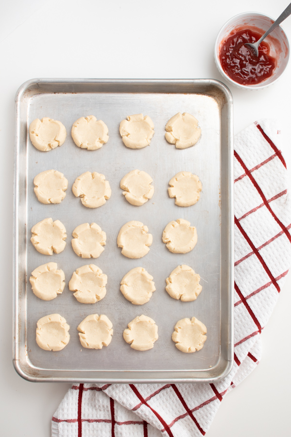 Thumbprint cookie recipes on a cookie sheet.