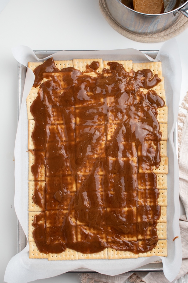 Toffee candy being made in a pan.