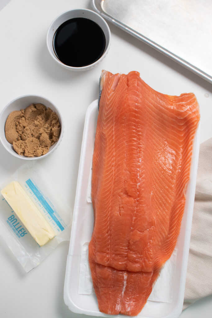 Baked salmon ingredients on a white table.