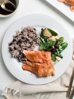 Brown sugar baked salmon on a white dinner plate.