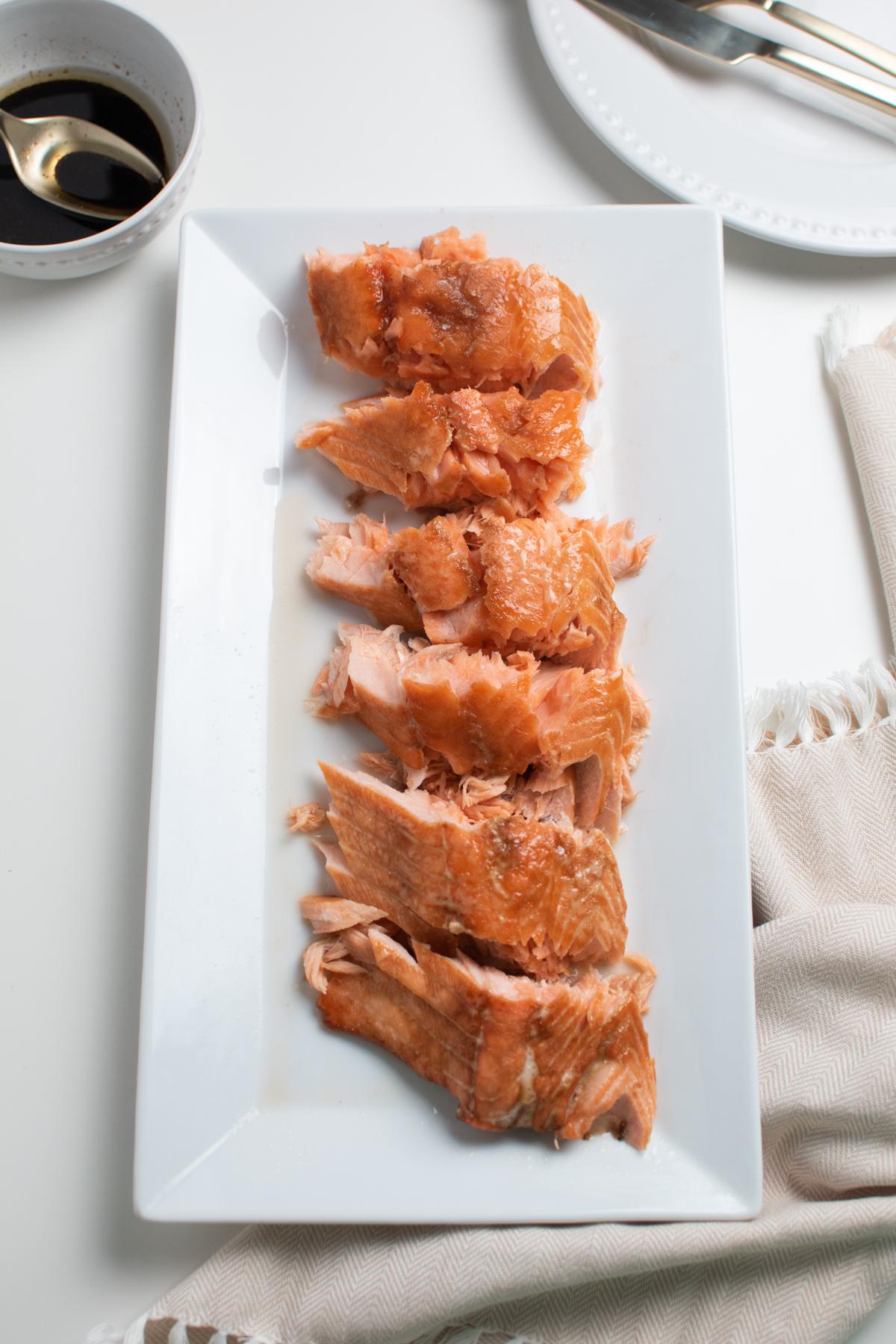 Brown sugar glazed salmon on a serving platter.