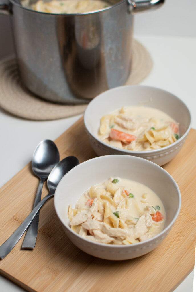 Two bowls of chicken noodle soup with cream of chicken.