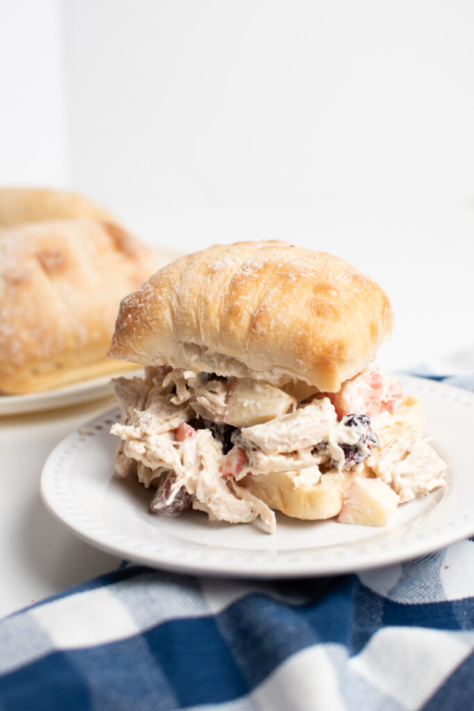 Chicken salad with grapes on a ciabatta roll.