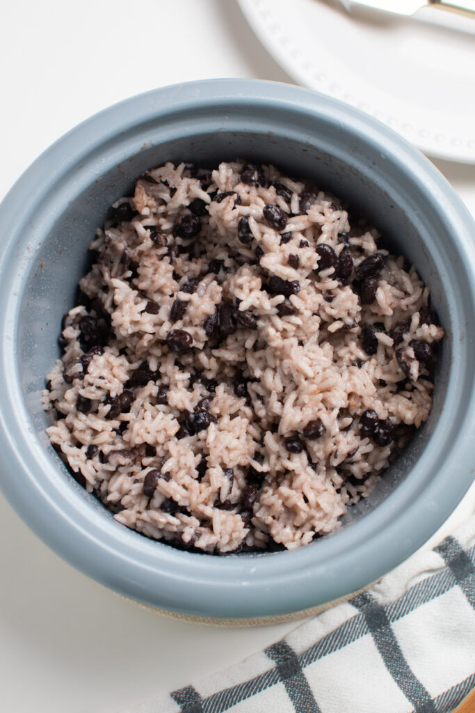 Coconut rice and black beans in a rice cooker.