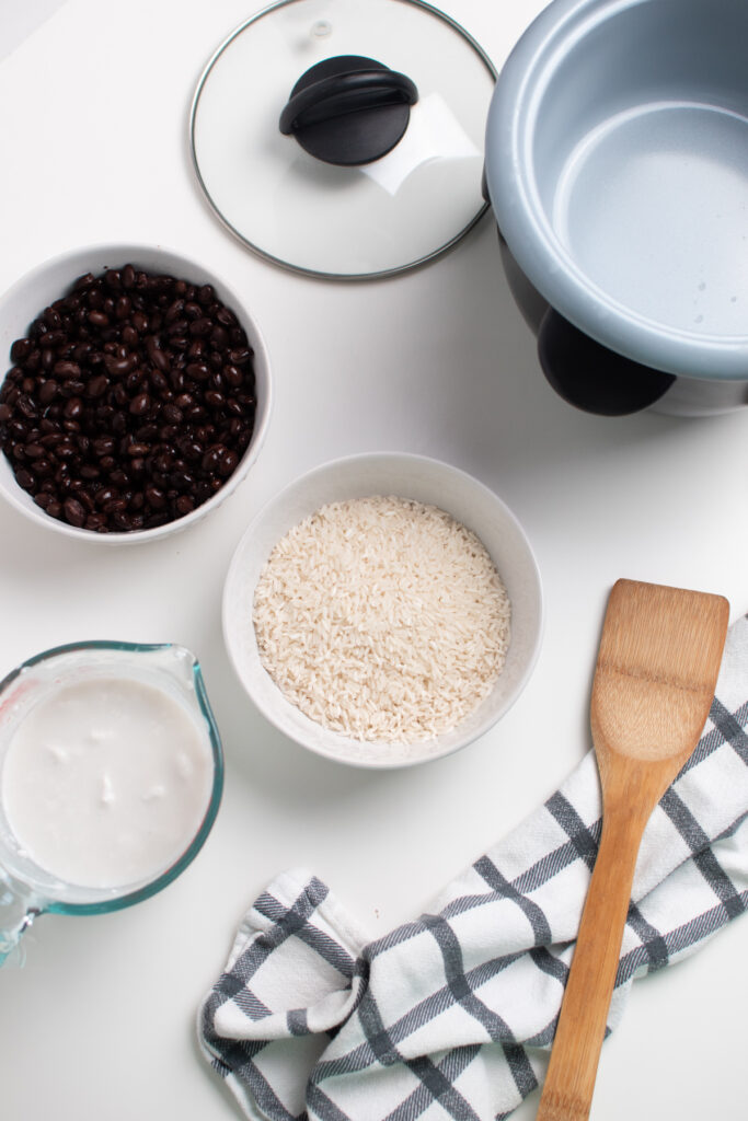 Coconut rice ingredients on a white table.