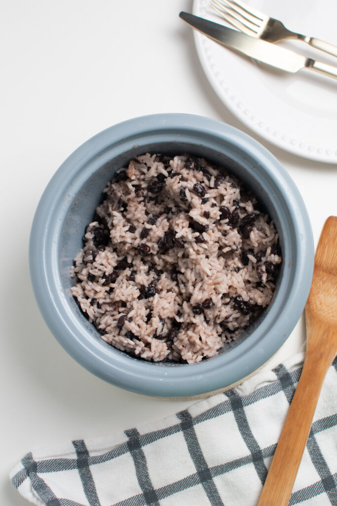 Coconut rice with black beans in a rice cooker.