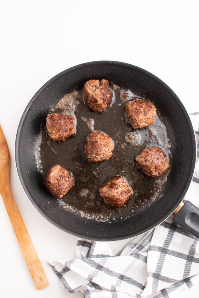Homemade meatballs for spaghetti in a fruing pan.