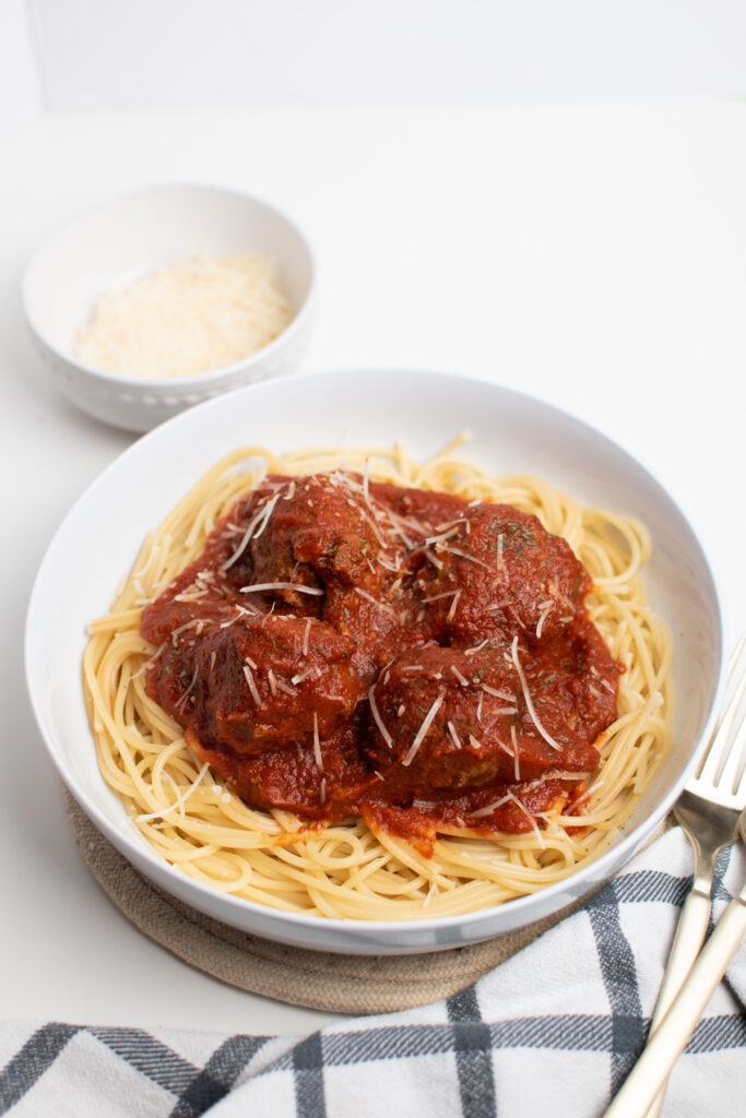 Spaghetti meatball sauce over pasta.
