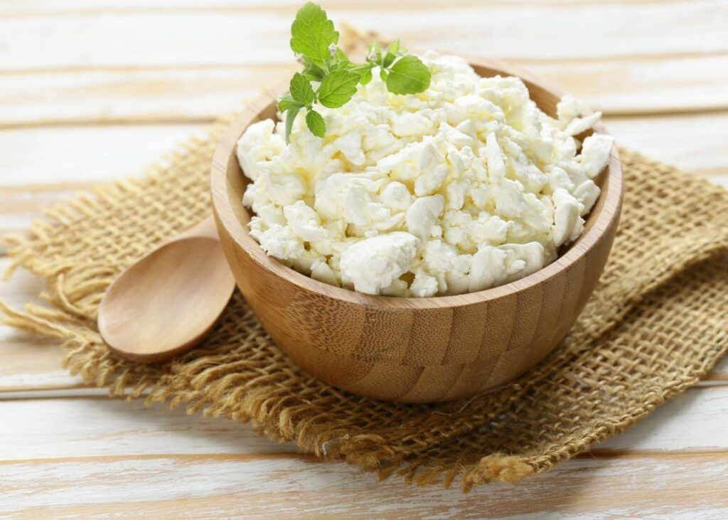 Cottage cheese in wooden bowl.