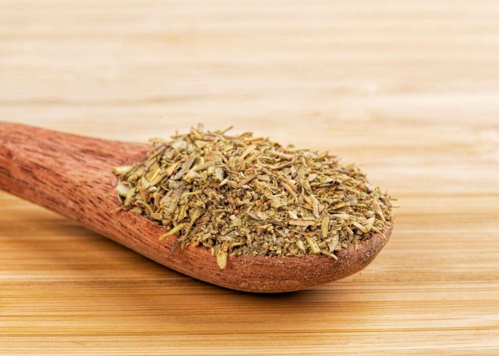 Italian Seasoning mix on wooden spoon.