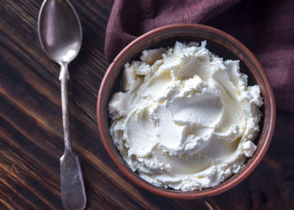 Vegan cream cheese sour cream substitute in wooden bowl.