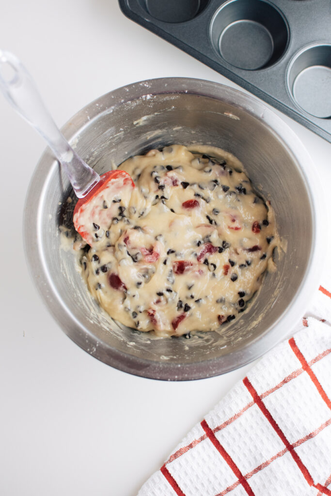 Cherry chocolate chip muffin batter in a mixing bowl.