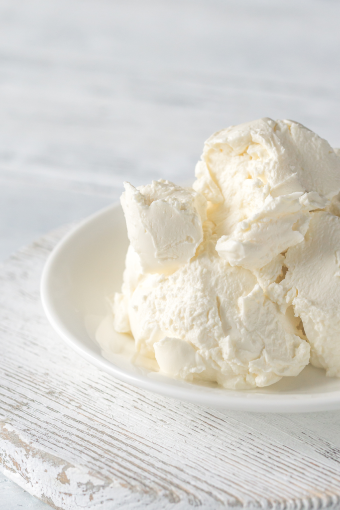 Marscapone cheese in a white bowl.