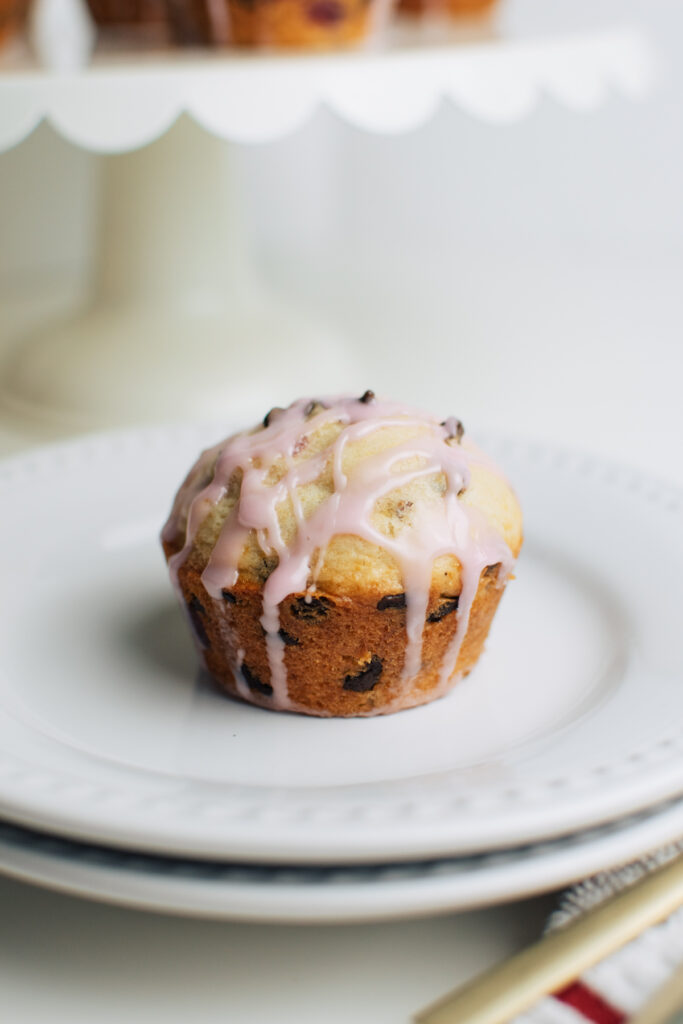 Mini chocolate chip muffin on a plate.