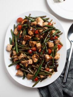 Platter of one pan balsamic chicken and veggies.