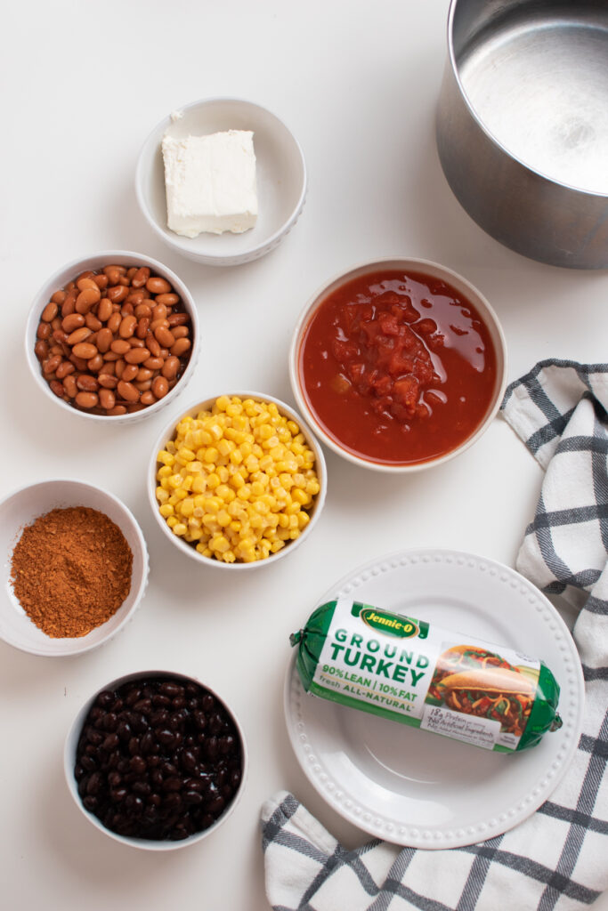 Taco soup ingredients on a white table.