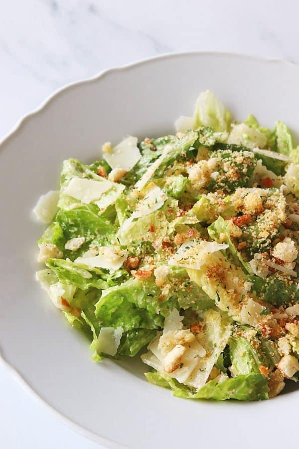 Breadcrumb Caesar salad in white bowl.