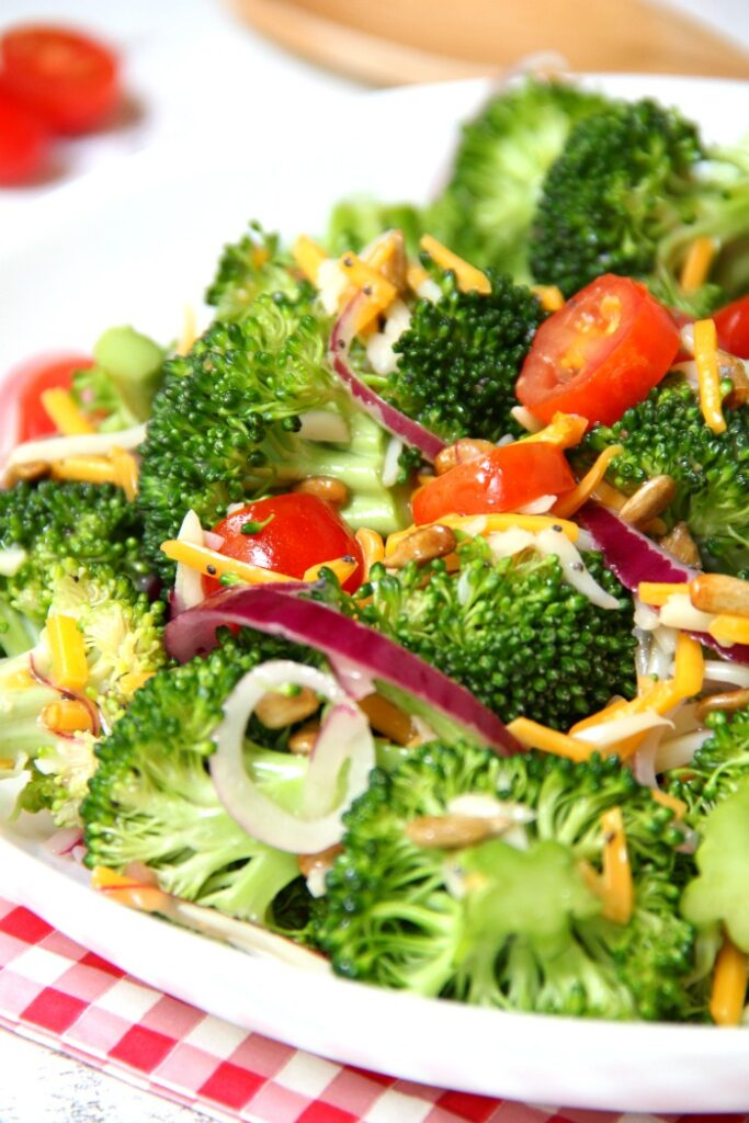 Bowl of broccoli and tomato salad.