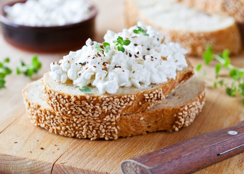 Cottage cheese on bread with garnish.