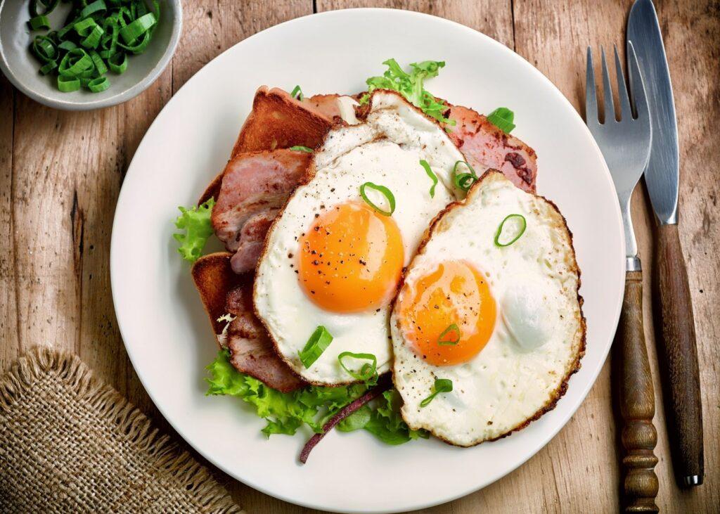 Fried eggs on sandwich.