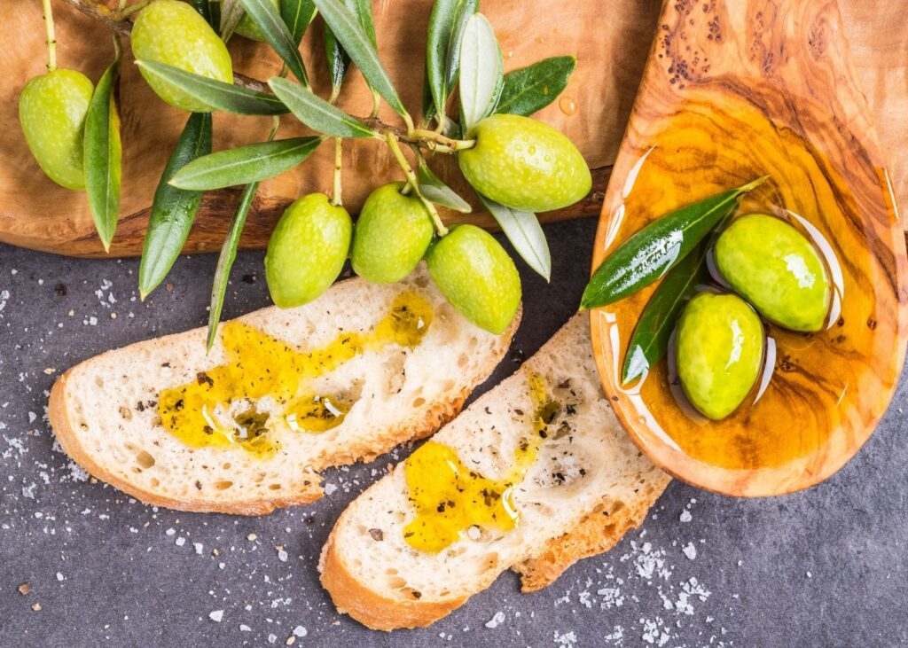 Toast drizzled with olive oil next to branch.